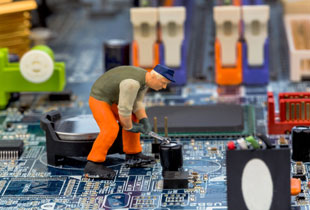 stock-photo-computer-board-and-workers-symbol-photo-for-computer-failure-maintenance-data-security-164650385.jpg